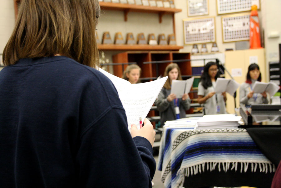 Soprano 1 Caitlin Kresta practices with her sectional during block lunch in the choir room before All State Pre-area.
