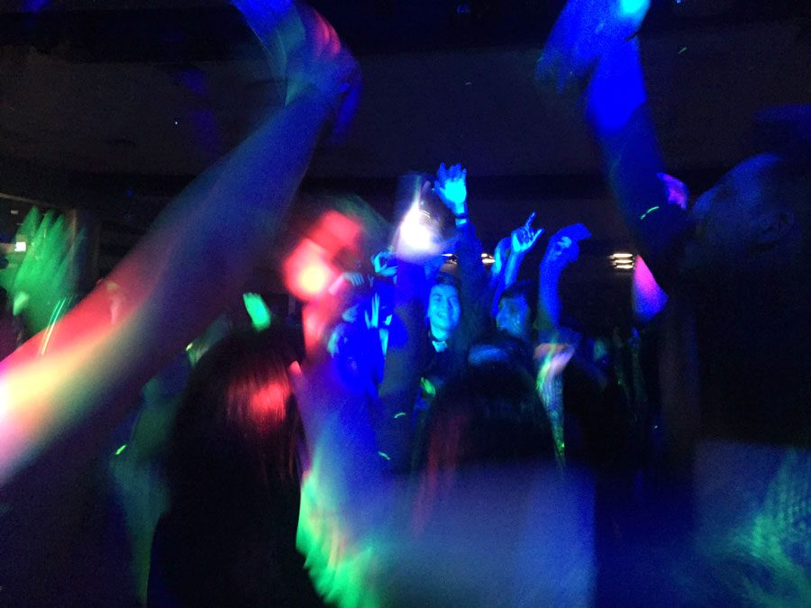 Students dance to the first song played during the homecoming dance. The dance began at 8 p.m. in the cafeteria.