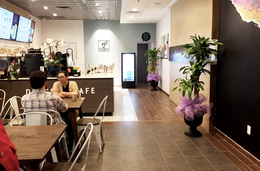The inside of the cafe has a bright and modern vibe that is inviting to customers.