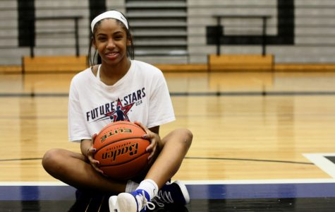 Freshman Cammie McKinney poses on the super H in the gym. McKinney is the only freshman on the varsity girls basketball team.