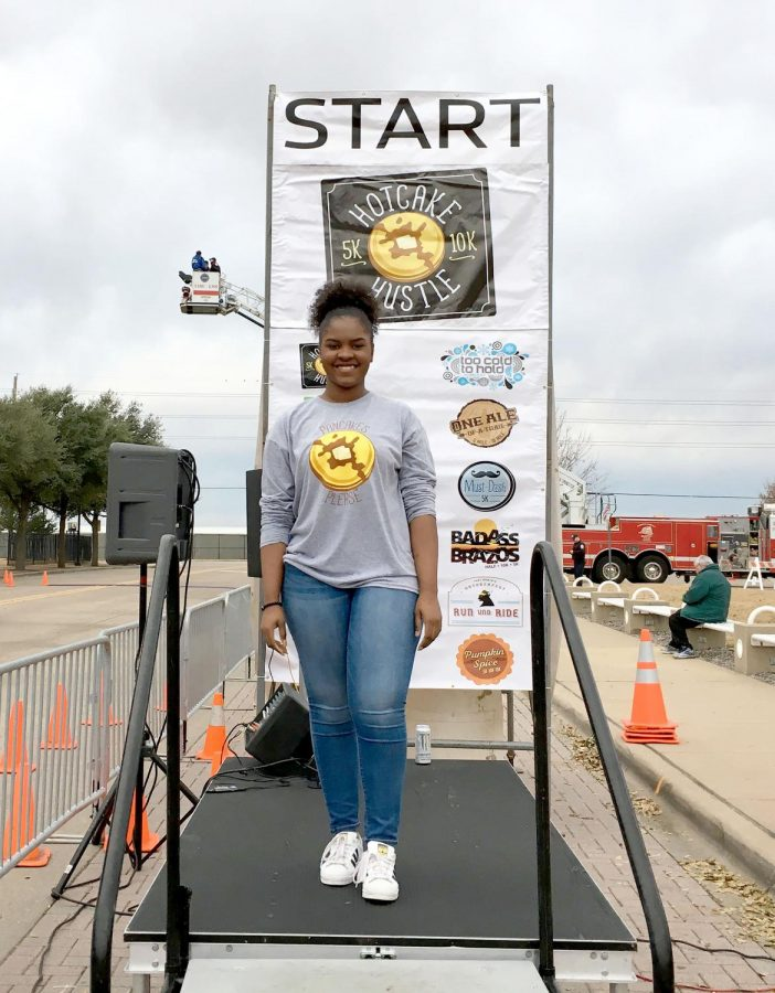Senior Hope Word poses at the Hotcake Hustle race while volunteering