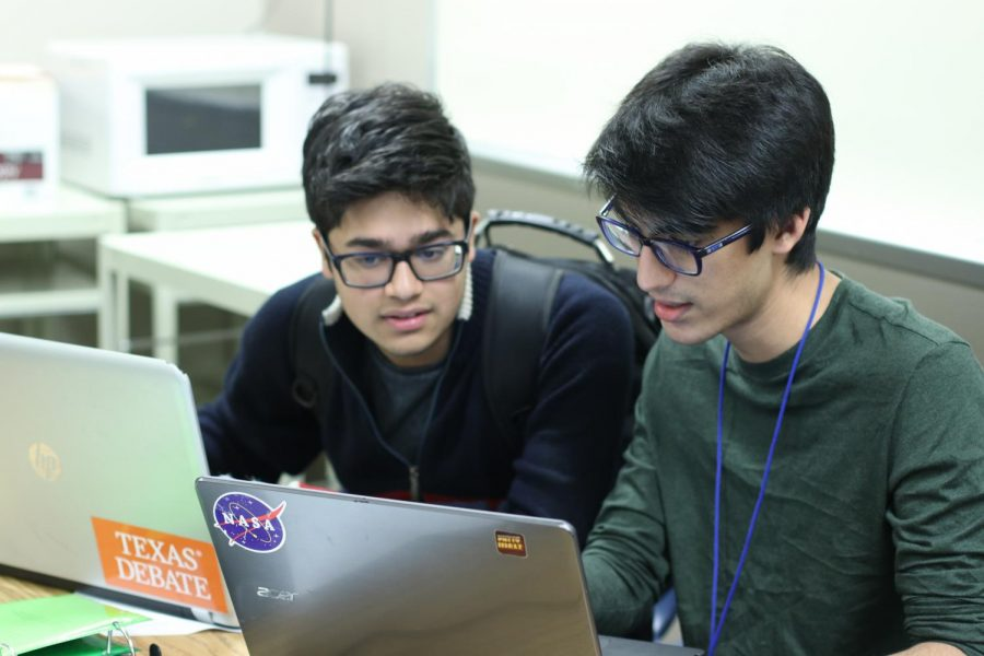 Juniors Krish Patel and Sameer Haq discuss debate tactics.