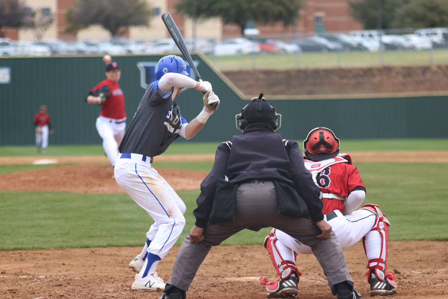 Senior Drake Boggan readies himself for the pitch. Hebron was playing against Arlington Martin on Feb 21.