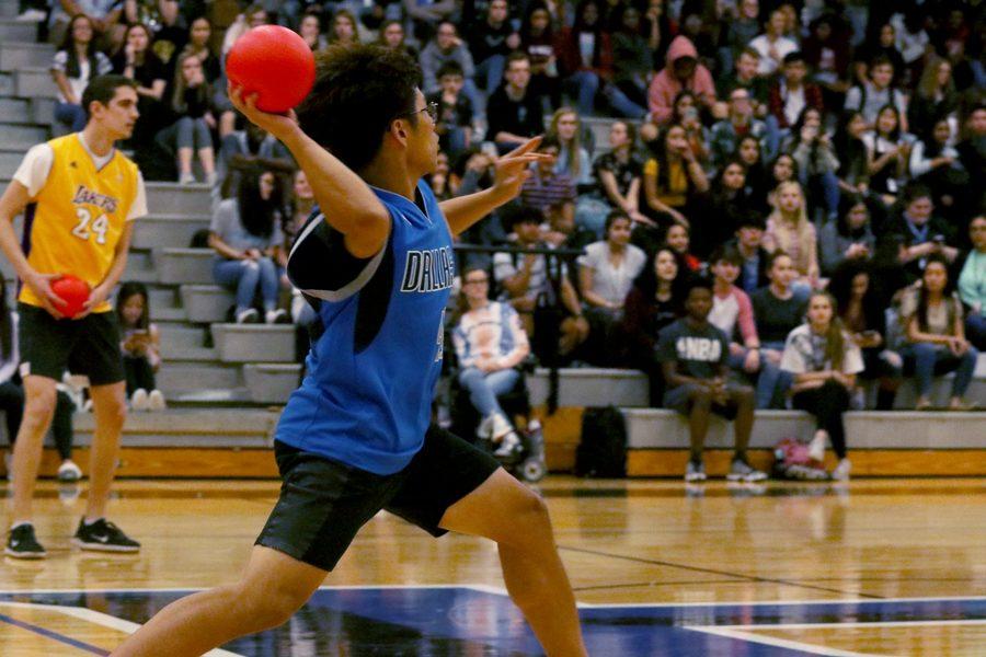 Senior Brandon Lee throws a ball at the opposing team.