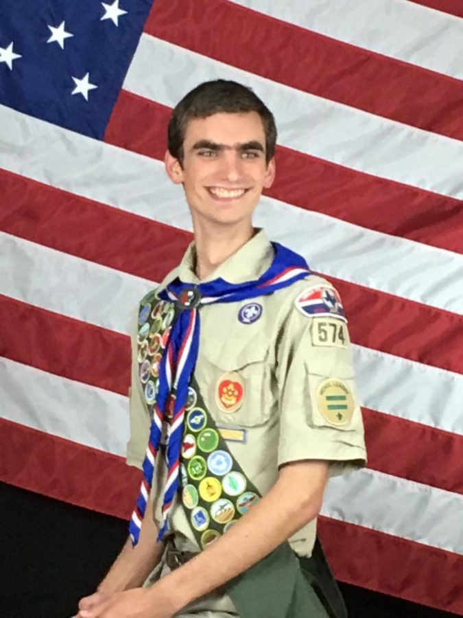 Senior Luke Deatherage poses for his Boy Scouts photograph.