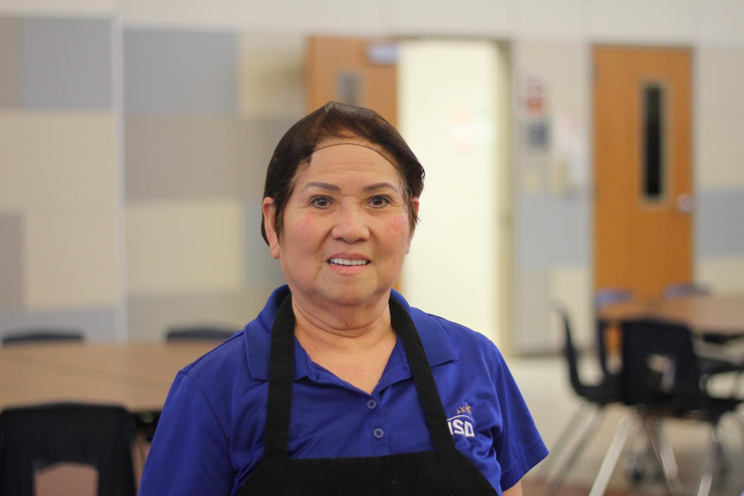 Cafeteria employee Sarin Lam poses for a photo. She shared her story of immigrating to America in 1975.