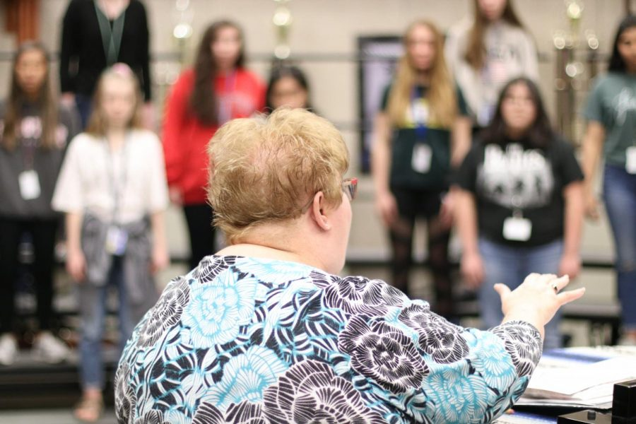 Rachel Forester conducts choir during rehearsal. The Spring show will be held on May 17.