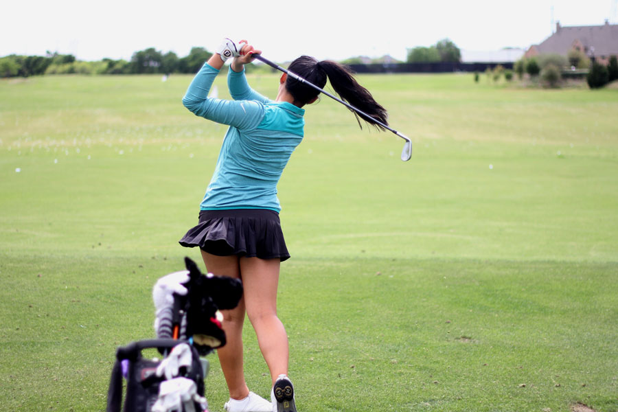 Senior Jennie Park practices as the Castle Hills Golf Course driving range on April 11. Park tied for first at the regional tournament and advanced to the state tournament for the fourth time.