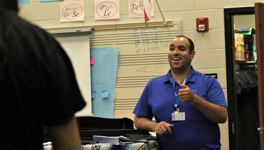"Choir director Alexander Carr teaches the soprano girls choir group during his second day at Hebron. Carr has already made a comfortable environment and connections with his students. ""I've only met a handful of them, but I'm interested in finding out more about them,"" Carr said."