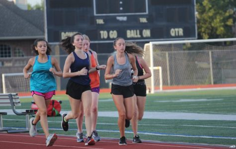"Freshman Isabella Garcia runs in a track workout with the team. Cross country does these on Tuesdays and Thursdays to work on speed and endurance to improve the runners' paces. ""Honestly I'm really excited to race with the team,"" Garcia said. ""None of the freshmen have really raced a 5k, so it's going to be a really fun season. I can't wait to break some new personal records and hopefully go to state with my team."""