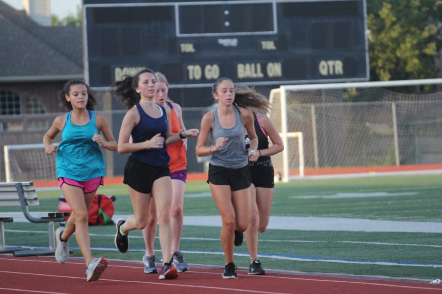 Freshman+Isabella+Garcia+runs+in+a+track+workout+with+the+team.+Cross+country+does+these+on+Tuesdays+and+Thursdays+to+work+on+speed+and+endurance+to+improve+the+runners%E2%80%99+paces.+%E2%80%9CHonestly+I%E2%80%99m+really+excited+to+race+with+the+team%2C%E2%80%9D+Garcia+said.+%E2%80%9CNone+of+the+freshmen+have+really+raced+a+5k%2C+so+it%E2%80%99s+going+to+be+a+really+fun+season.+I+can%E2%80%99t+wait+to+break+some+new+personal+records+and+hopefully+go+to+state+with+my+team.%E2%80%9D