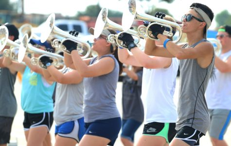 """Senior Rhett Reasonover plays warm-ups with the rest of the mellophone section. He hopes to have a great last year with the band. """"I'm looking forward to getting this last year with all my senior friends before we all go to different colleges,"""" Reasonover said. """"And getting the most out of my last year in this band."""""""