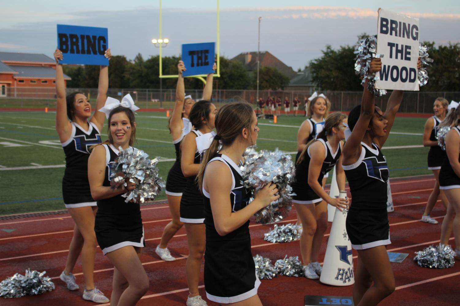 The+cheerleaders+motivate+the+crowd+to+cheer+louder+and+%E2%80%9Cbring+the+wood.%E2%80%9D+They+are+there+to+motivate+the+audience+and+the+football+players+by+yelling%2C+cheering%2C+and+performing+stunts+for+the+crowd.+%0A