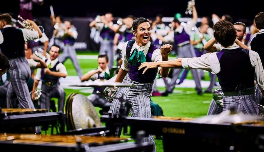 "Rezazadeh performs ""The Wrong Side of the Tracks"" with the The Cavaliers. The show included music by Christopher Rouse, Thomas Newman, Donald Grantham, Mike McIntosh and Clif Walker and placed fifth at the DCI World Championships."