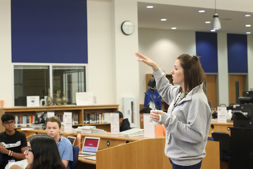 AP Human Geography teacher, Kelley Ferguson, talks to her first period class about an upcoming assignment in the library on Sept. 11. Ferguson and pre-AP English 1 teacher, Cassie Madewell, both took turns talking about each subjects' assignments.