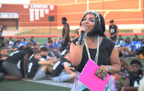"Student Council sponsor Jennifer Russell introduces the senior football moms for their dance at the homecoming community pep rally on Sept. 25. They performed a dance to songs like ""Old Town Road"" and many more with their sons on the football field at the homecoming parade."