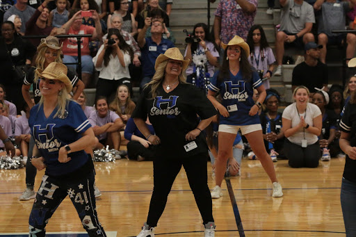 The football players' mom's dance at the pep rally on Friday. The pep rally was held in the gym for the community and students to attend.