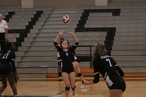 Sophomore Alexandra Geer passes the ball to her teammate. This is Greer's second year playing on the JV team.