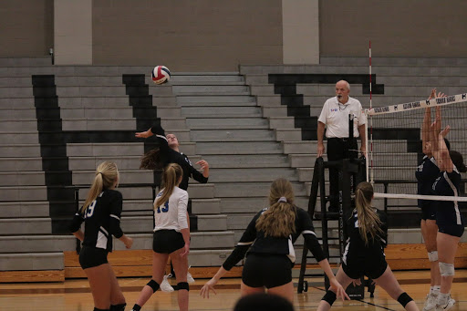 Sophomore+Samantha+Stahl+jumps+to+hit+the+ball.+She+started+off+the+game+with+strong+serves+and+was+gaining+points+fast.