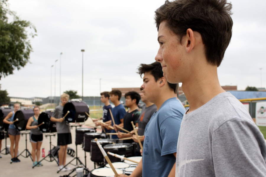 Sophomore Parker Freeburg practices his part for the upcoming game against Coppell on Friday. The band will be competing at Grand Nationals in Indianapolis in November.