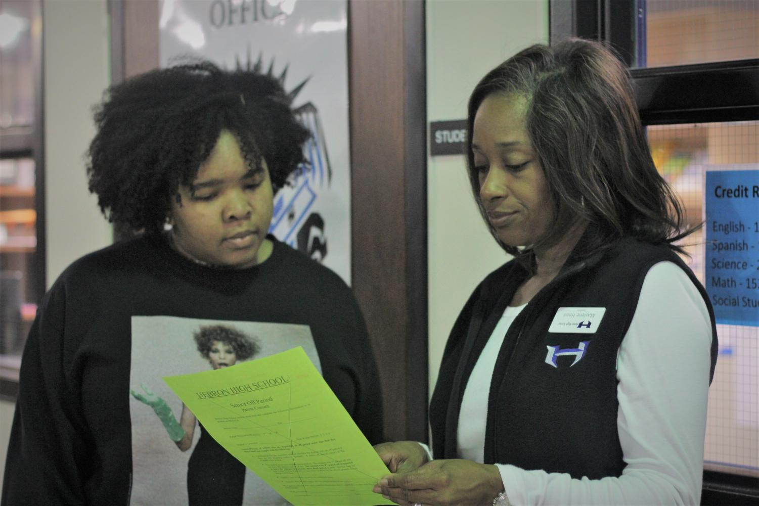 Counselor Marlene Hood assists a student with her schedule before 1st period starts.  The counseling department is hosting a workshop to fill out the FAFSA on Monday.