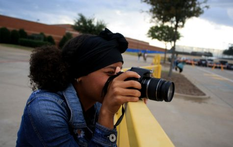 Sophomore journalism student Erica Grimmett-Pratt takes photos for an assignment on September 26. The photos were used for