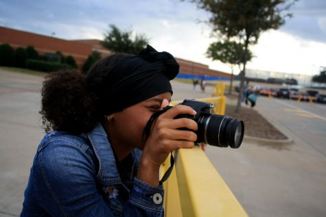 "Sophomore journalism student Erica Grimmett-Pratt takes photos for an assignment on September 26. The photos were used for ""Photo Shoot 2."""