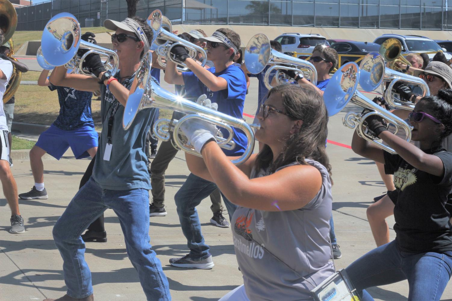 Sophomore mellophone player Susanna Egelston rehearses choreography with the rest of the brass sections during 3rd period the Wednesday before BOA Dallas. Band utilizes time during their separate class periods to supplement material learned altogether during after school rehearsals.
