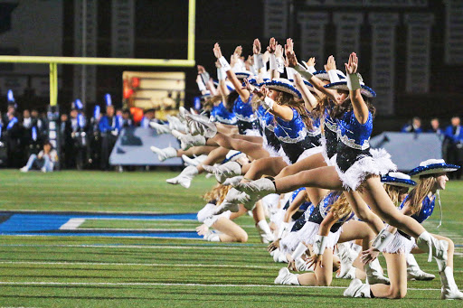 "Silver Wings performs to the band's rendition of ""Dynamite"" by Taio Cruz during halftime. The team learned the choreography in one class period."