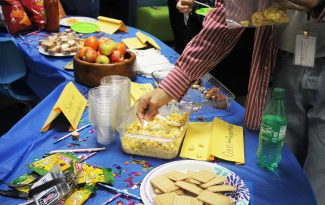 Students serve different kinds of cultural foods that some of them made themselves in the Hawk's Nest on October 9 while listening to Hispanic music and dancing. At the event, judges determined the winner of the salsa contest.