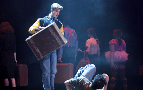 The cast performs a hectic train station scene. Sophomore Braxton Dietz plays Cedric and Sophomore Ali Niaz plays Wayne.