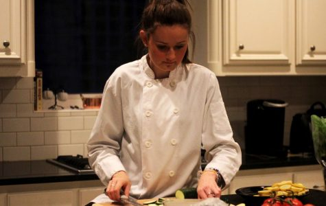 """Junior Tara O'Donnell cooks ratatouille, a stewed vegetable dish, in her kitchen. She wears the chef's coat that she won while on Chopped Junior. """"I love to cook different dishes,"""" O'Donnell said. """"My favorites to cook are mediterranean, french and asian dishes."""""""