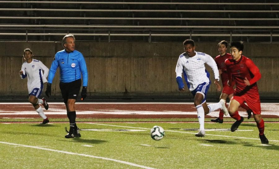 Senior Omar Thompson runs to get the ball before the Coppell player. Thompson was the leading scorer in the game.