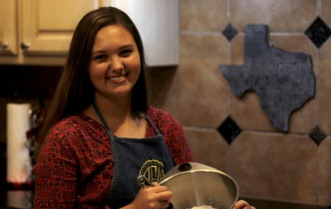 Sophomore Audri Fleming smiles as she bakes cookies for a customer. Fleming has been baking since eighth grade and plans to attend the Culinary Institute of America after high school.
