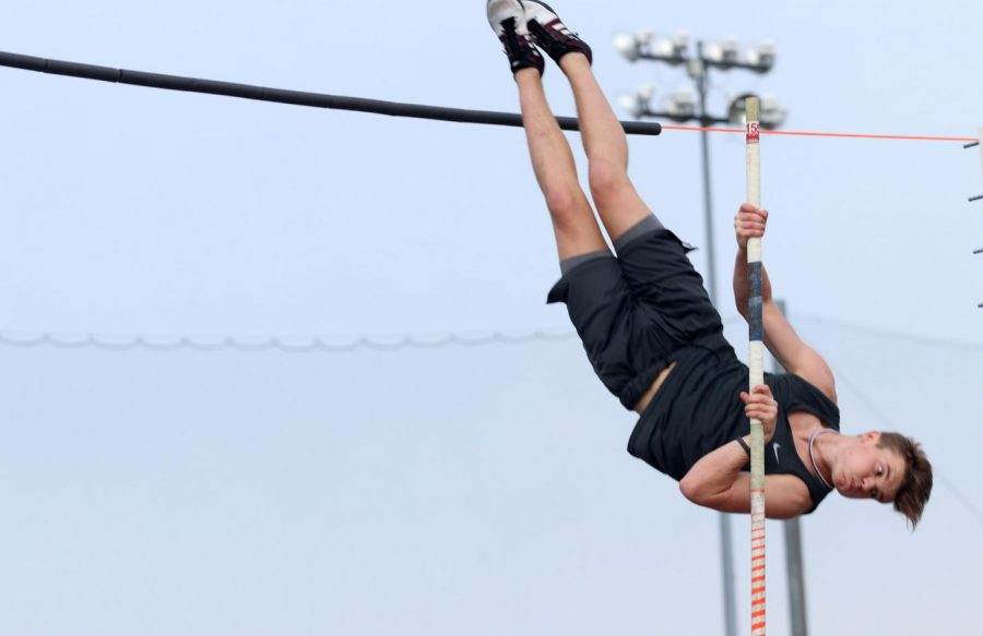 "Junior Lucas Huckeba jumps 13 feet while pole vaulting. He practices almost every day during fourth period and after school. ""To be a good pole vaulter, you need to be a good athlete,"" pole vault coach David Brown said. ""It always helps to have good speed, and the main thing is that you're not scared of getting up on a tall stick 16 feet in the air."""