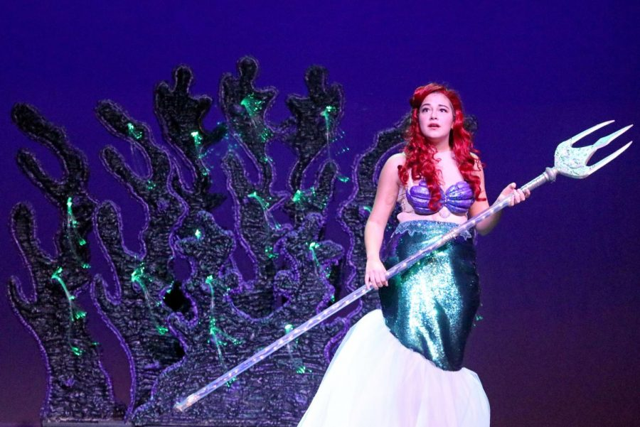 Ariel stands with her father's trident, which she took back from Ursula after confronting and defeating her. Eventually, she returned the trident to her father, King Triton, who gave her back her legs so that she could return to her prince.