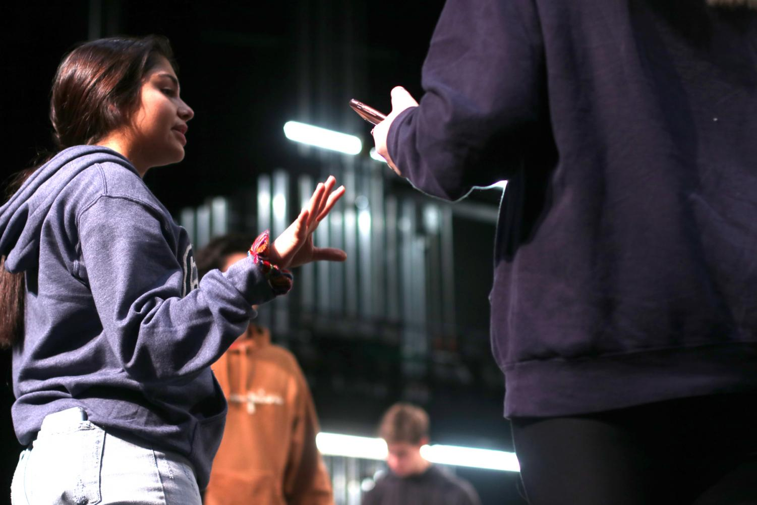 """Junior Michelle Arriaga helps coordinate a scene for the musical, """"The Little Mermaid."""" Head director Ramina Mirmortazavi chose to direct the musical this year instead of Heitzman because of her love for """"The Little Mermaid."""""""