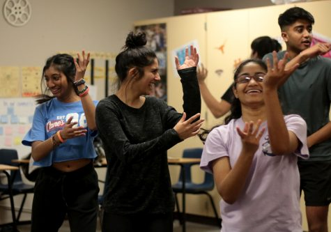 Junior Vaneeza Moloo practices an Indian Bollywood inspired dance afterschool in English teacher Jeanette Rook's room. The group will perform their dance at the Hawk Multicultural Fest on Feb. 29.