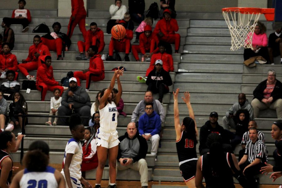 Power forward Camille Thomas shoots a three-pointer. The Lady Hawks played MacArthur earlier in the season and lost 49-51.