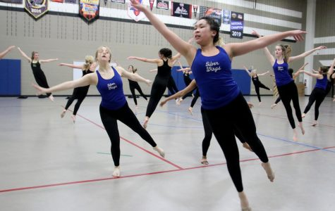 Junior Rachel Pham practices with the other elite team for their group dance. Practices for the competition are held every morning at 7:30 for everyone who is competing.