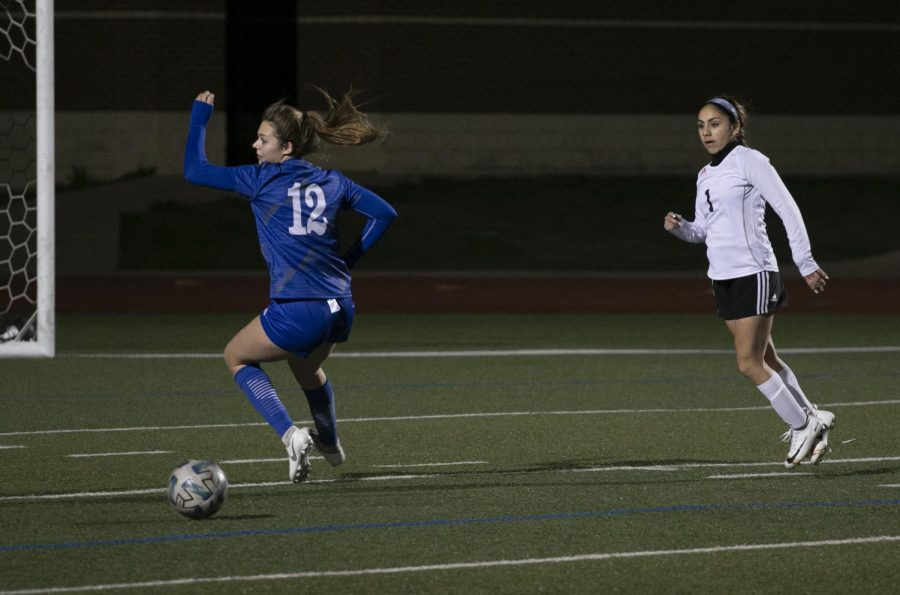 Senior Briley Weatherford turns to chase a missed pass. Weatherford scored the first goal of the match early in the first half. She also scored the third goal from a shot deflected off the opposite goal post.