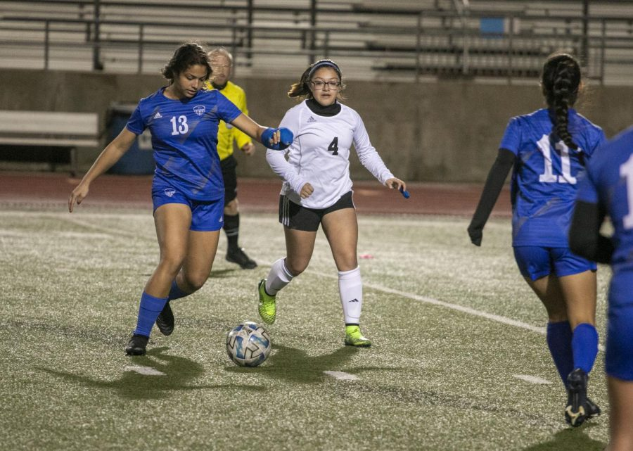 Senior Malia Ramdhanny takes the ball down the field. Ramdhanny was playing with a broken wrist, but continued to play as aggressively as the rest of the team.