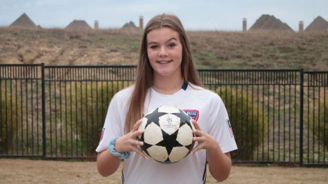 "Freshman Eleanor Hays poses with a soccer ball. She plays soccer for the FC Dallas U-16 development academy for Girls. ""The development academy focuses on developing our skill and our talent so we can go farther with soccer into college and possibly professionally,"" Hays said."
