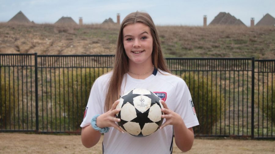 Freshman+Eleanor+Hays+poses+with+a+soccer+ball.+She+plays+soccer+for+the+FC+Dallas+U-16+development+academy+for+Girls.+%E2%80%9CThe+development+academy+focuses+on+developing+our+skill+and+our+talent+so+we+can+go+farther+with+soccer+into+college+and+possibly+professionally%2C%E2%80%9D+Hays+said.