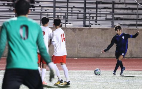 Senior Mason Booe lines up a free kick. Booe was injured earlier in the season with a sprained meniscus, but was still a leader on the sidelines throughout the season.