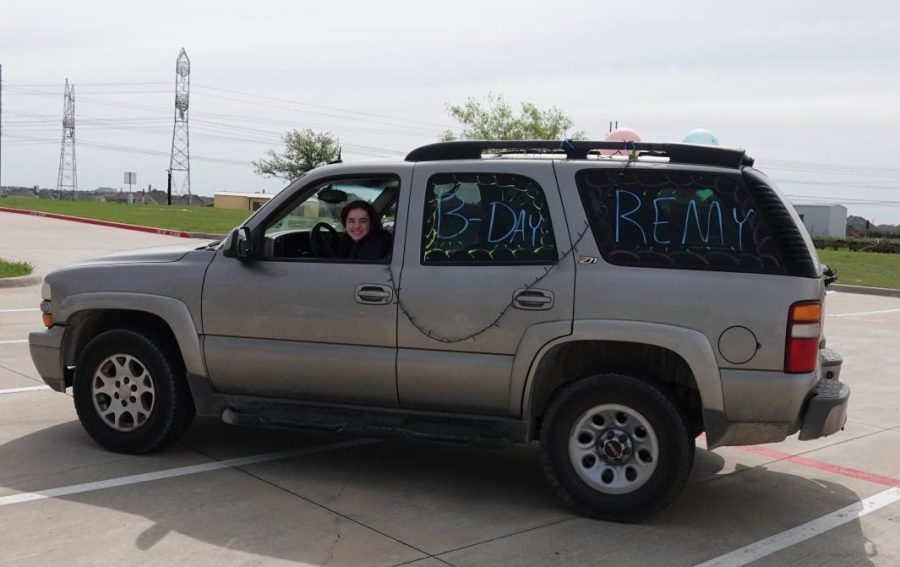 Sophomore Ainsley Carmichael sits in her decorated car, waiting until everyone is ready to wish Wieber a happy birthday. Carmichael, along with a few other girls, painted their cars in order to make Wieber feel special on her 16th birthday.