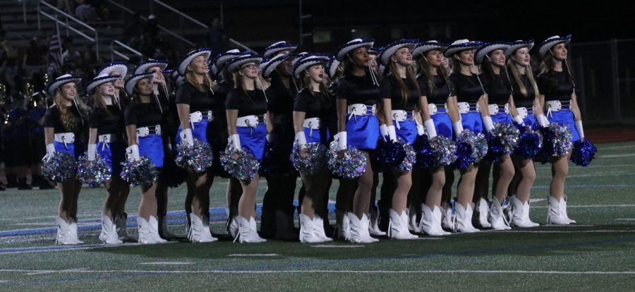 "The Silver Wings prepare to perform at halftime during a football game on August 30. After football season ended, the girls started preparing for their annual Spring Show which has been canceled due to COVID-19. ""As hard as practices were, I miss them a lot,"" captain Mariah McCardell said. ""We have a habit of complaining about waking up super early, but at the end of the day, those girls are what got me through those early mornings and now I don't get to see them. I wish I had taken the time to realize how lucky I am."""