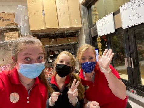 "Junior Ellory Liles and two of her coworkers pose together for a photo with their required face masks and gloves. ""We are all required to wear face masks and gloves no matter what position we are inside the restaurant,"" Liles said."