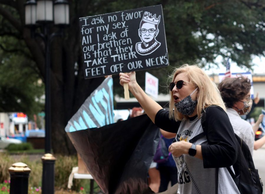A protestor holds her sign during a rally held in Dallas to honor Ginsburg. Many of these powerful women are inspired by Ginsburg and hope to continue her legacy.