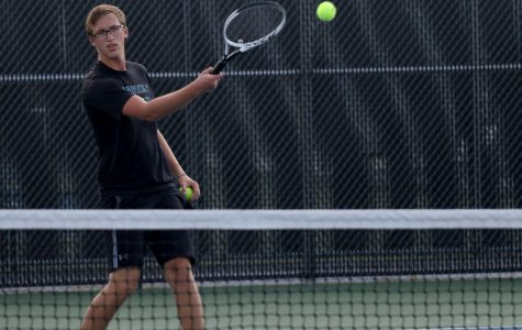 Senior Ben Grider plays a singles match during fourth period Sept. 15. The tennis team has been practicing drills and is focusing on skill-oriented training.